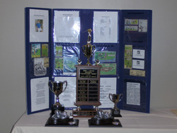 Pavlos Memorial and Brady Cup Trophies on Display at Registration Desk