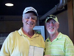 Mike Robinson accepting congratulations from Bill Murray on his Hole-in-One at Tippecanoe tournament.